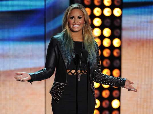 "The 2012 MTV Video Music Awards are this week and the performances are always something to look forward to. The pre-show will be opened by the ""Skyscraper"" singer, Demi Lovato. With her latest hit single ""Give Your Heart A Break,"" the X-Factor judge will surely amp us up for the main show."