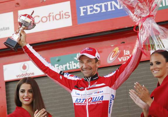 """Katusha Team rider Denis Menchov of Russia celebrates after winning the 20th stage of the Tour of Spain """"La Vuelta""""."""
