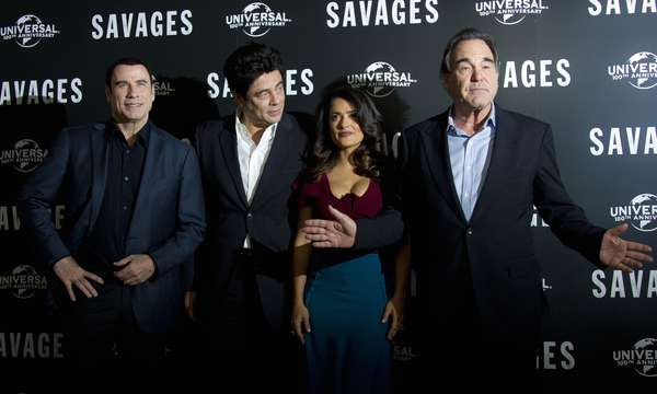 The film directed by Oliver Stone, 'Savages,' has made its way across the pond. The cast met up in London for a photo call where John Travolta, Benicio del Toro, Salma Hayek and the director posed for the photogs.