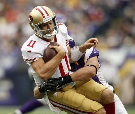 San Francisco 49ers quarterback Alex Smith (11) is sacked by Minnesota Vikings linebacker Chad Greenway during the first half of their NFL football game in Minneapolis, September 23, 2012.