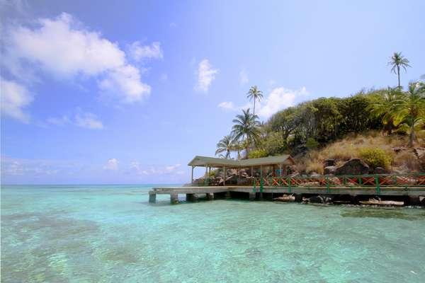 Providencia, Colômbia: ilha do arquipélago de San Andrés, no Caribe colombiano, Providencia tem praias paradisíacas com um estilo rústico sem pretensões de luxo. Hotéis e restaurantes têm preços baixos e recebem os turistas com num ambiente relaxado e muita simpatia dos locais