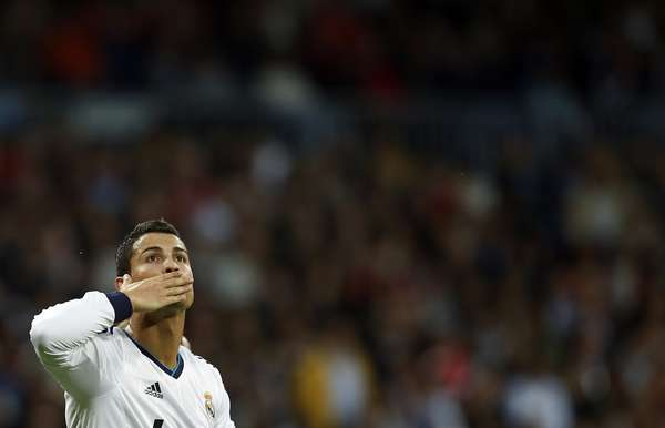 Real Madrid's Cristiano Ronaldo celebrates his goal against Celta Vigo during their Spanish First Division soccer match at Santiago Bernabeu stadium in Madrid October 20, 2012. REUTERS/Susana Vera (SPAIN - Tags: SPORT SOCCER)