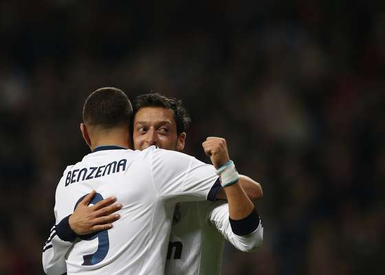 Real Madrid's Karim Benzema (L) congratulates teammate Mesut Ozil on his goal against Athletic Bilbao.