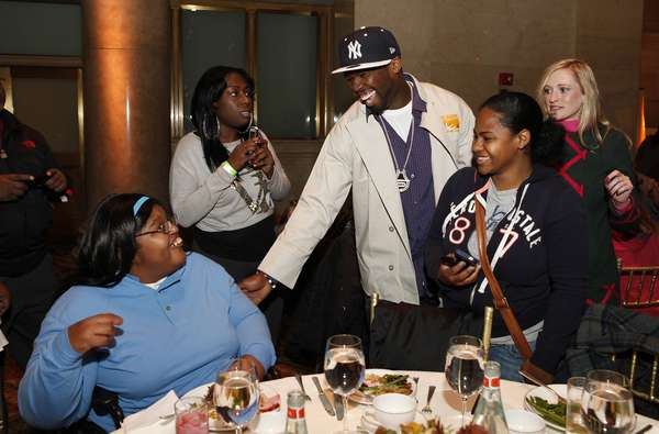 50 Cent greets people affected by Hurricane Sandy and joins Feeding America and the Food Bank for NYC to serve Thanksgiving meals to people in need at Cipriani on Wednesday, November 21, 2012, in New York.