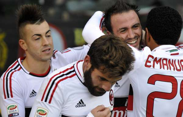 AC Milan Giampaolo Pazzini (2nd R) celebrates with his teammates Stephan El Shaarawy (L), Antonio Nocerino (2nd L) and Urby Emanuelson after scoring.