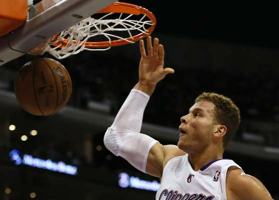 Los Angeles Clippers Blake Griffin slam dunks against the Toronto Raptors during their NBA basketball game in Los Angeles, California, December 9, 2012.
