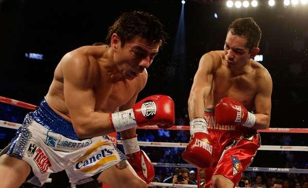 El filipino Nonito Donaire venció por nocaut en el tercer asalto al mexicano Jorge 'El Travieso' Arce y retuvo su corona de los supergallos de la Organización Mundial de Boxeo (OMB), en pelea efectuada en Houston (Texas).