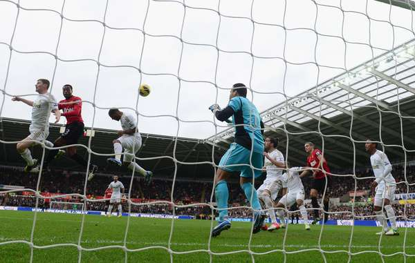 Patrice Evra scores with a header to put Man United ahead.