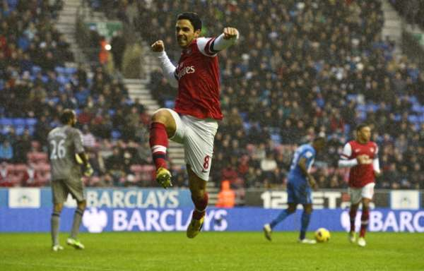 Arsenal beat Wigan by the minimum to rise to fourth place in the Permier League.