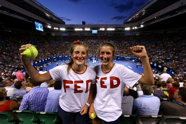 Two Roger Federer fans cheer for the great Swiss during his match against Davydenko.