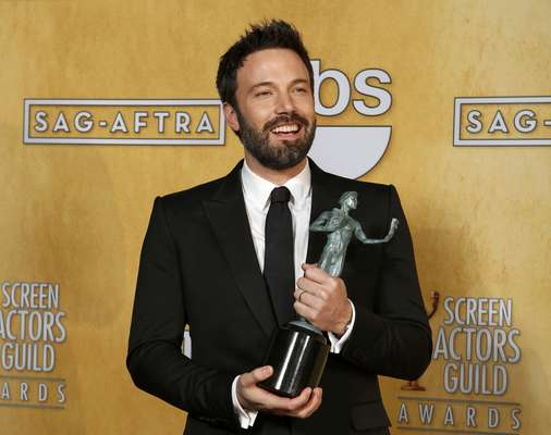 "Hollywood came together to honor the best talent in film and television at the Screen Actors Guild Awards. Take a look at the lucky recipients of the Actor!Director and actor Ben Affleck holds the award for outstanding performance by a cast in a motion picture for ""Argo"" at the 19th annual Screen Actors Guild Awards in Los Angeles, California January 27, 2013."