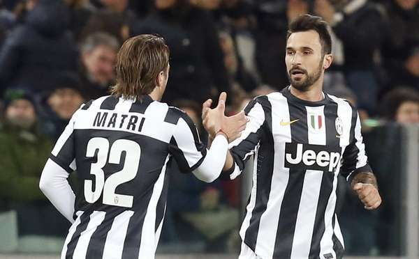 Juventus' Mirko Vucinic (R) celebrates with Alessandro Matri after scoring.