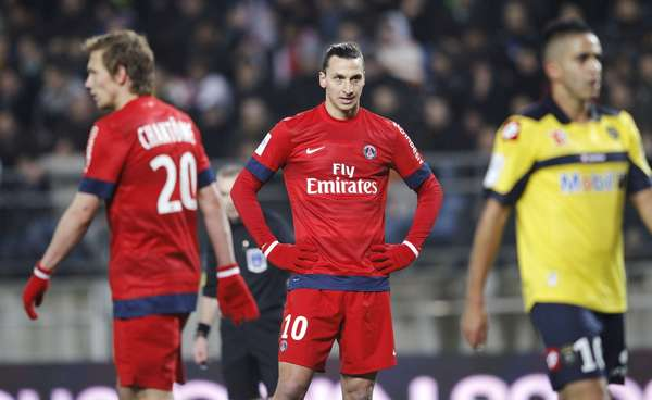 Paris Saint Germain's Zlatan Ibrahimovic (C) reacts next to team mate Clement Chantome (L) and Sochaux's Sebastien Roudet (R) during their French Ligue 1 soccer match at the Bonal stadium in Sochaux February 17, 2013.