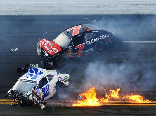 Kyle Larson, driver of the #32 Clorox Chevrolet, and Regan Smith, driver of the #7 Clean Coal Chevrolet, are involved in an incident at the finish of the NASCAR Nationwide race Saturday.