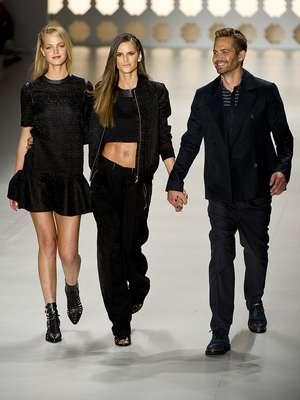 El actor estadounidense Paul Walker, de la película `Rápido y Furioso', y los Ángeles, como son llamadas las modelos contratadas por Victoria's Secret - Izabel Goulart e Erin Heatherton marcaron el cuarto día de desfiles de la Sao Paulo Fashion Week