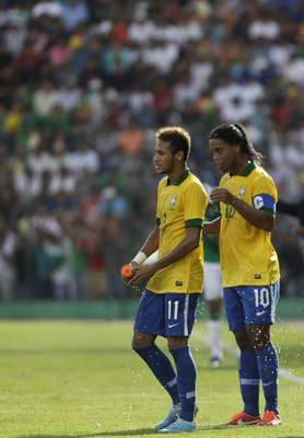Neymar (L) and Ronaldinho of Brazil are seen during a international friendly soccer match against Bolivia at Ramon Tauchi Aguilera Stadium in Santa Cruz.