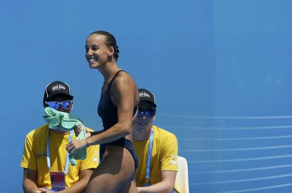 A italiana Tania Cagnotto protagonizou nesta terça-feira uma das disputas mais emocionantes da edição 2013 do Mundial de Esportes Aquáticos. Em briga direta com a chinesa He Zi, ela perdeu a medalha de ouro no trampolim de 1 m dos saltos ornamentais no último salto, por 0,1 ponto
