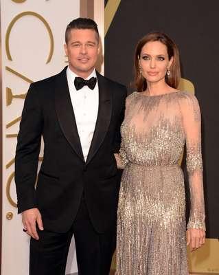 Brad Pitt e Angelina Jolie chegam ao Dolby Theatre, em Los Angeles, para a cerimônia da 86ª edição do Oscar