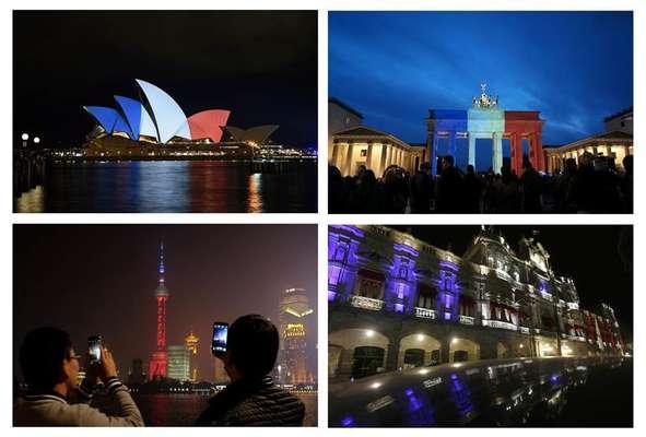 Monumentos históricos pelo mundo se iluminam pela França
