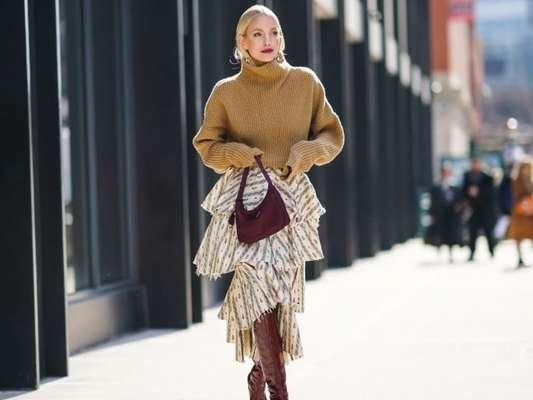 Moda das botas de cano longo voltam como trend no street style